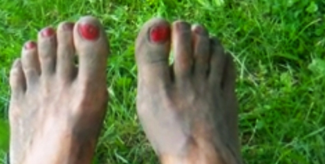 Photo: Muddy feet with red painted nails